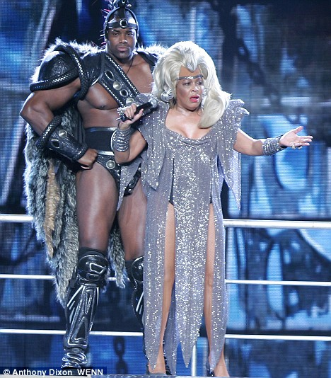 Tina Turner is 69 here and donning her Mad Max Beyond Thunderdome outfit.