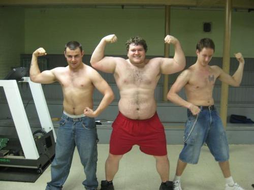 Shirtless musclecub flexing